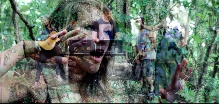 A still from the Don Johnston video Rising with images layered on top of each other. The band are playing in a wood and on top of the image there's a close up of female singer Mazrah