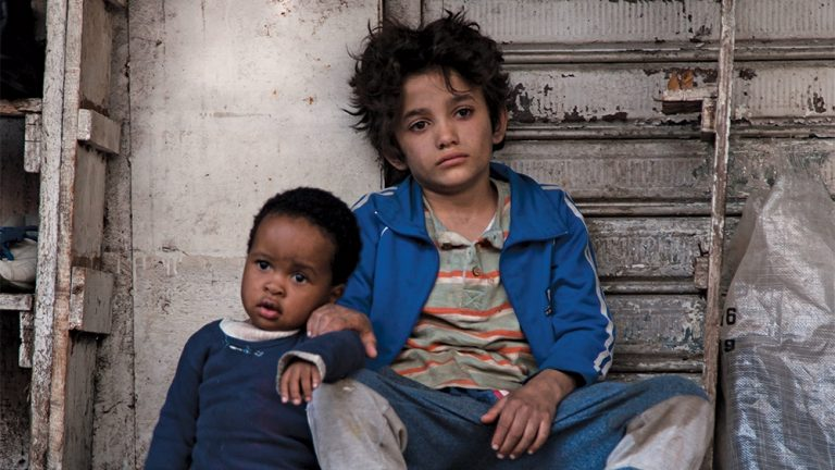 capernaum still. two you children sat on a stair