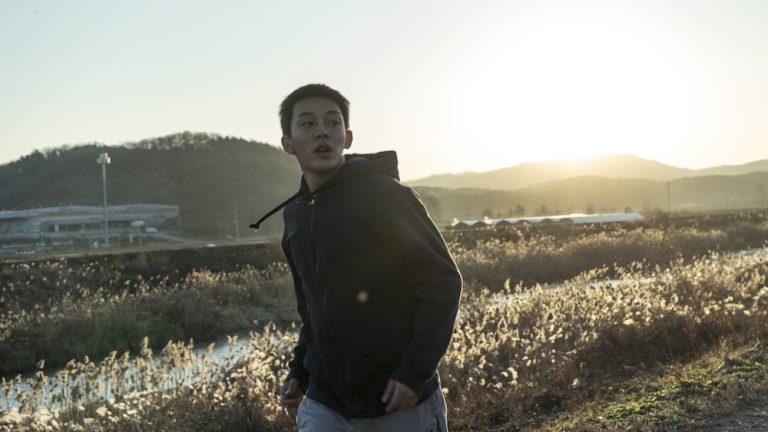 A still from the film Burning, directed by Lee Chang Dong. A young man is a field