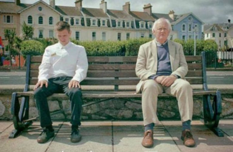 The Silent poster. An older man and a young man sitting on a bench
