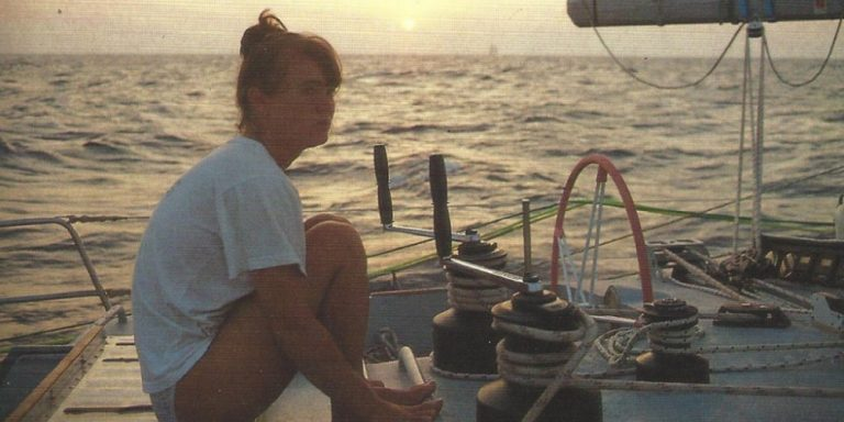 Maiden documentary. Skipper Tracy Edwards sitting on top of the boat at sunset