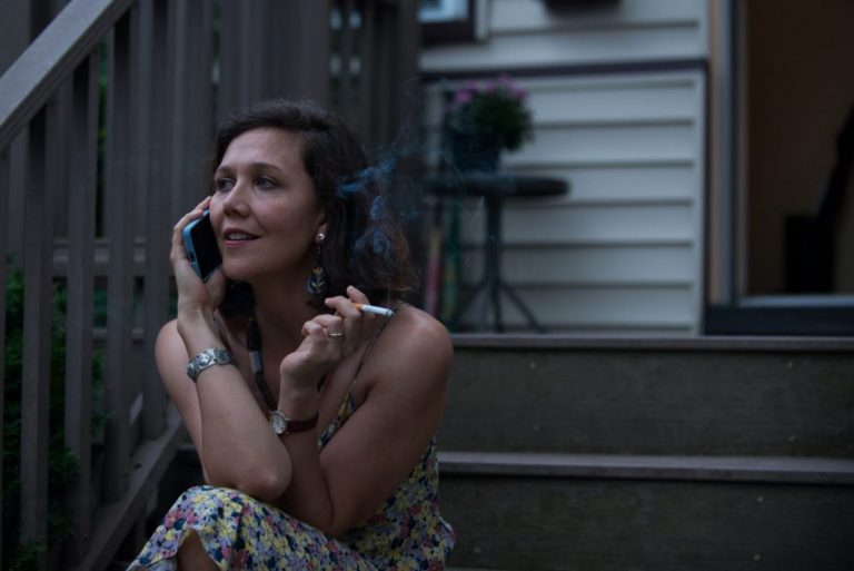 Maggie Gyllenhall in the Kindergarten Teacher on a step smoking a cigarette while on the phone